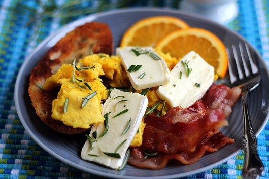 Scrambled Eggs with Bacon, Brie, and Rosemary