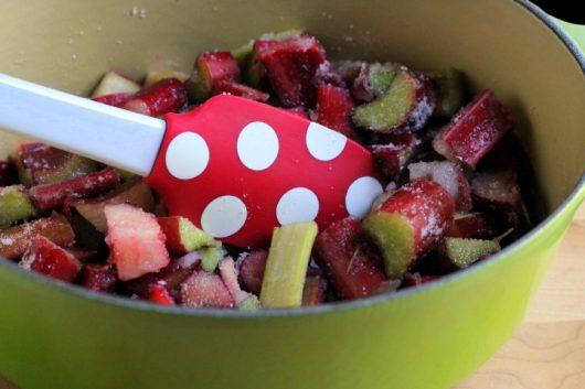rhubarb sauce in pot with polka dot spatula