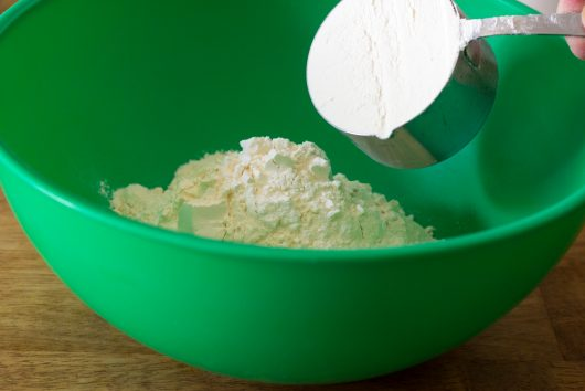 put 4 cups of flour in a large bowl