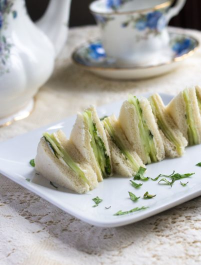 cucumber and mint sandwich with tea pot in background