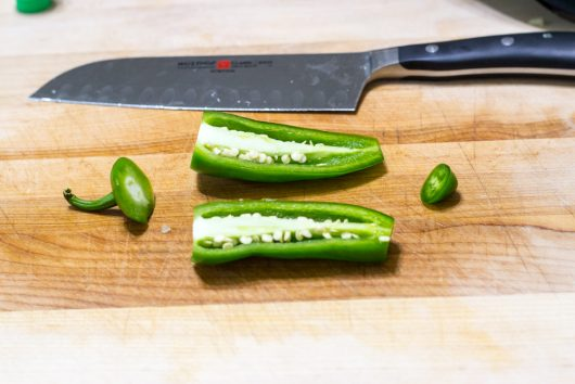 remove ribs and seeds from jalapeno