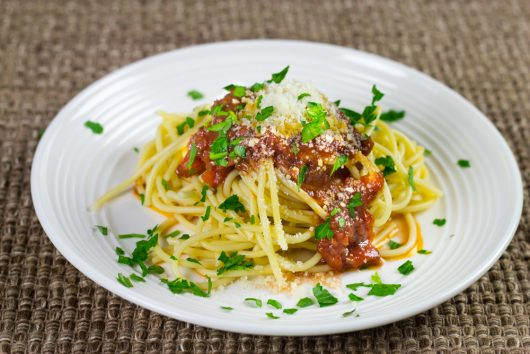 garnish the spaghetti with chopped parsley