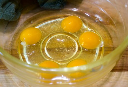 five eggs in a mixing bowl