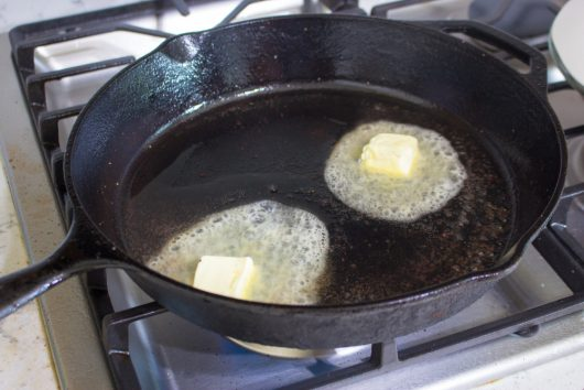 butter melting in a cast iron skillet
