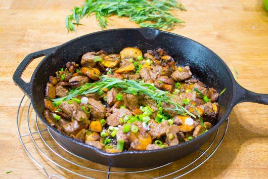 sprig of fresh tarragon atop Skillet Steak Dinner