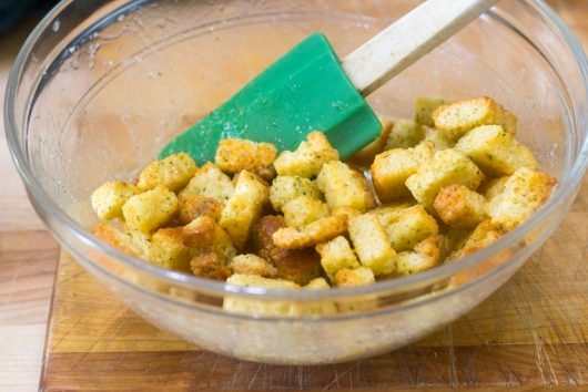 tossing the croutons in butter
