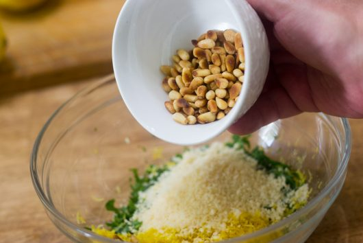 adding the nuts for Green Beans Gremolata