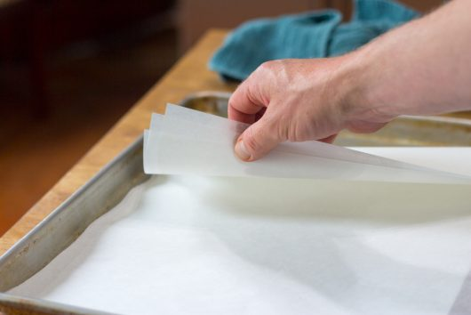 lining the baking sheet with 3 layers of parchment paper