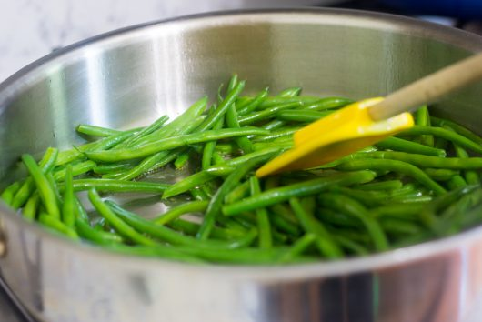 sauteing the beans for Green Beans Gremolata