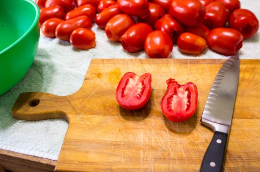 halving the tomatoes