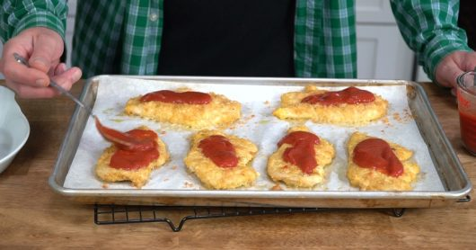 spoon cutlets with tomato sauce for Crispy Baked Chicken Parmesan